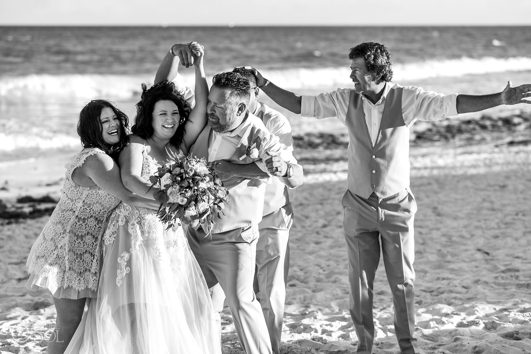 bride and groom having fun with guests Iberostar Grand Paraiso beach wedding