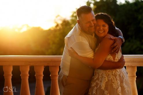 happy bride and groom hugging Iberostar Grand Paraiso wedding