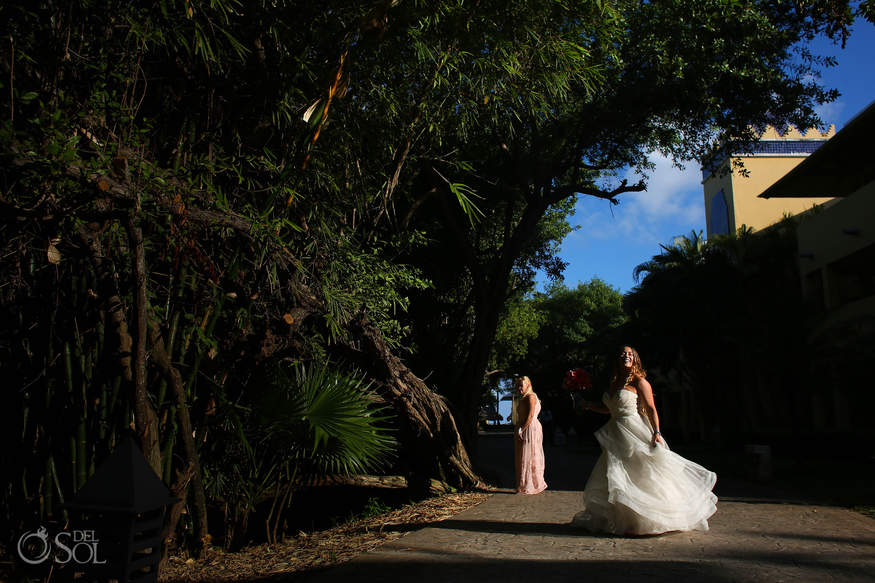 bride spinning in the sunlight on the way to her Iberostar Paraiso del Mar wedding wearing a Matthew Christopher wedding dress