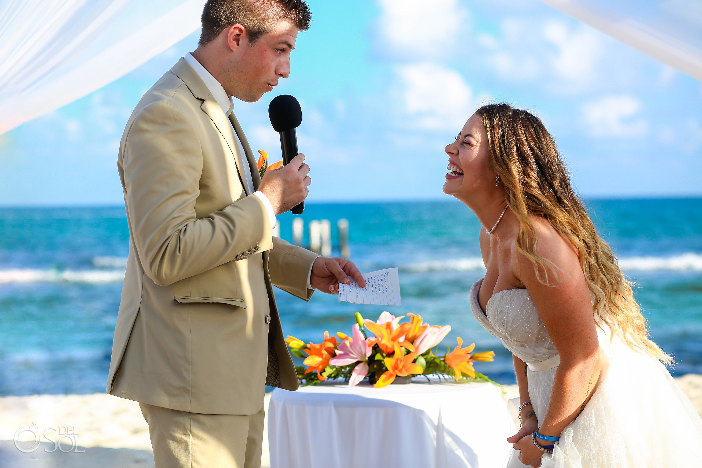 bride laughs at groom reading his vows Iberostar Paraiso del Mar Wedding