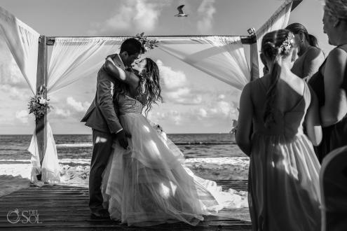 First kiss with bird flying overhead Iberostar Paraiso del Mar Wedding Cancun