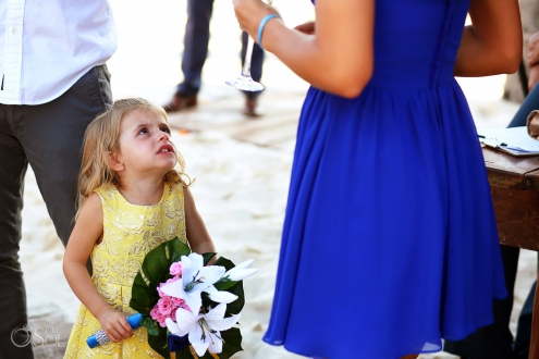 Funny wedding photo, little girl looking angry holding bridesmaid's bouquet Iberostar Paraiso del Mar Wedding