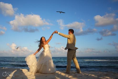 Sunset portrait happy dancing Matthew Christopher wedding dress Iberostar Paraiso del Mar Wedding