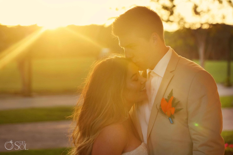 groom kisses bride on forhead perfect golden hour sunset portrait Iberostar Paraiso del Mar Wedding