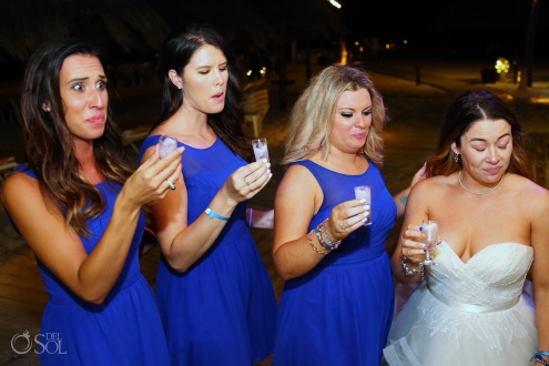 bride and bridesmaids pulling funny faces after drinking shots Iberostar Paraiso del Mar Wedding Reception