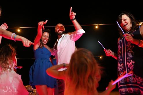 wedding guests dancing with toddler Iberostar Paraiso del Mar Wedding reception Riviera Maya Mexico