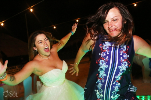 funny wedding photo of bride dancing with friend Iberostar Paraiso del Mar Wedding