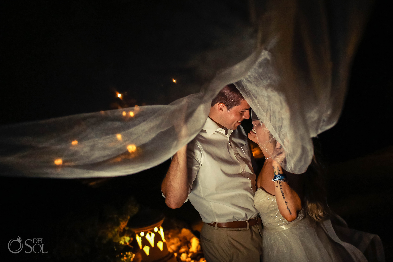 bride and groom portrait laughing under long bridal veil Iberostar Paraiso del Mar Wedding