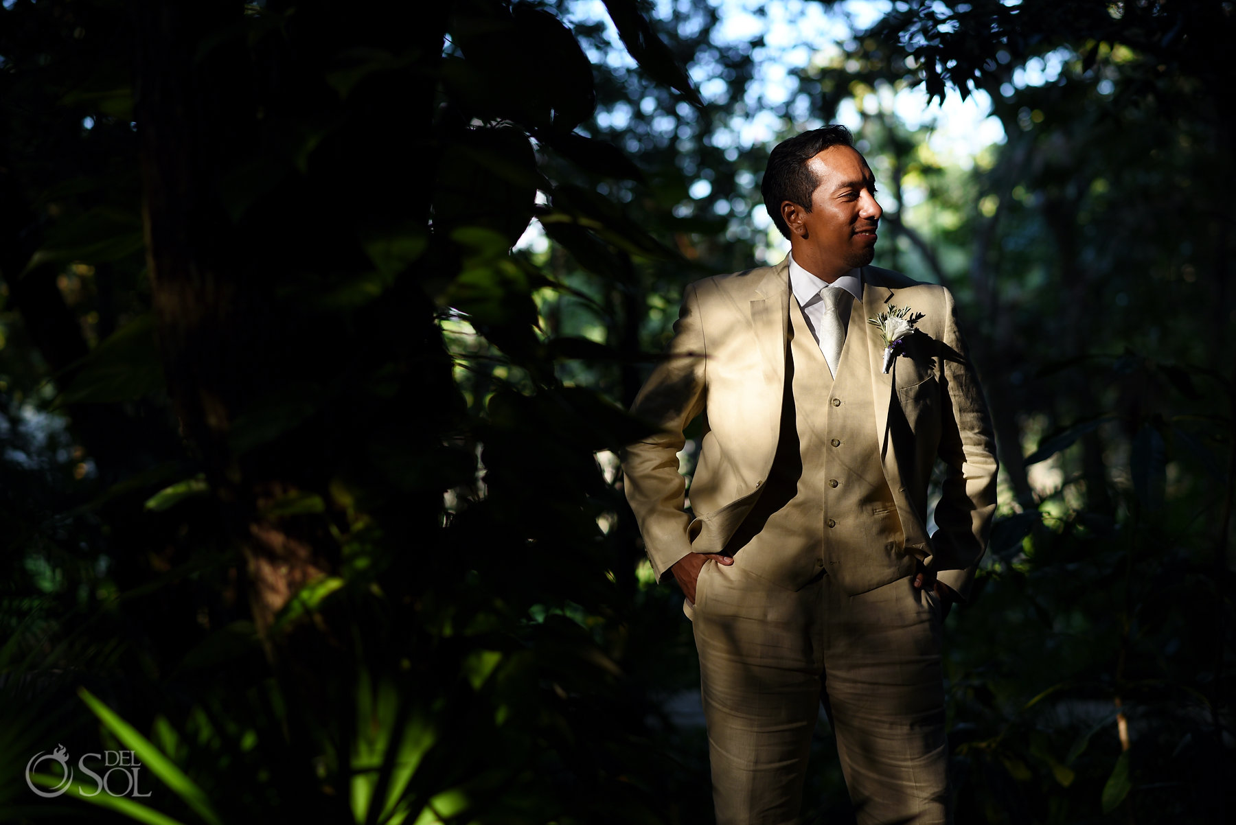 Groom portrait wearing beige three piece suit Dreams Tulum sunset wedding
