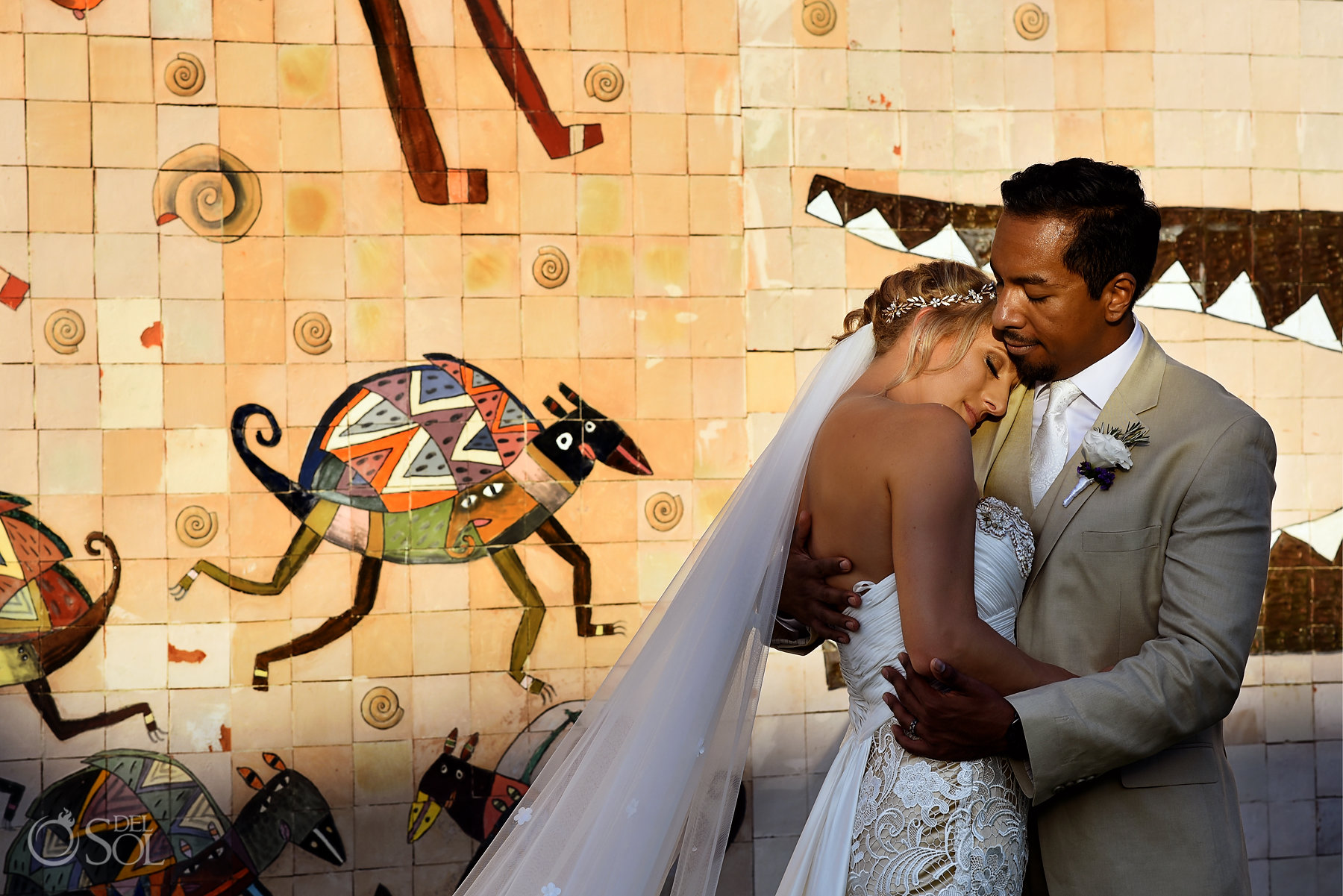 Dreams tulum sunset wedding portrait beside mosaic mural wall