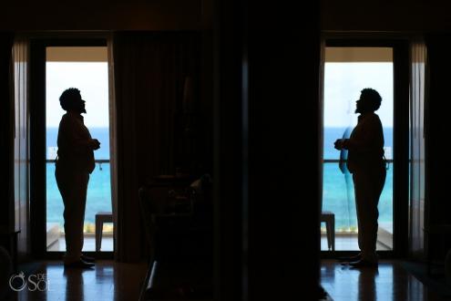 groom getting ready silhouette Hyatt Ziva Cancun wedding