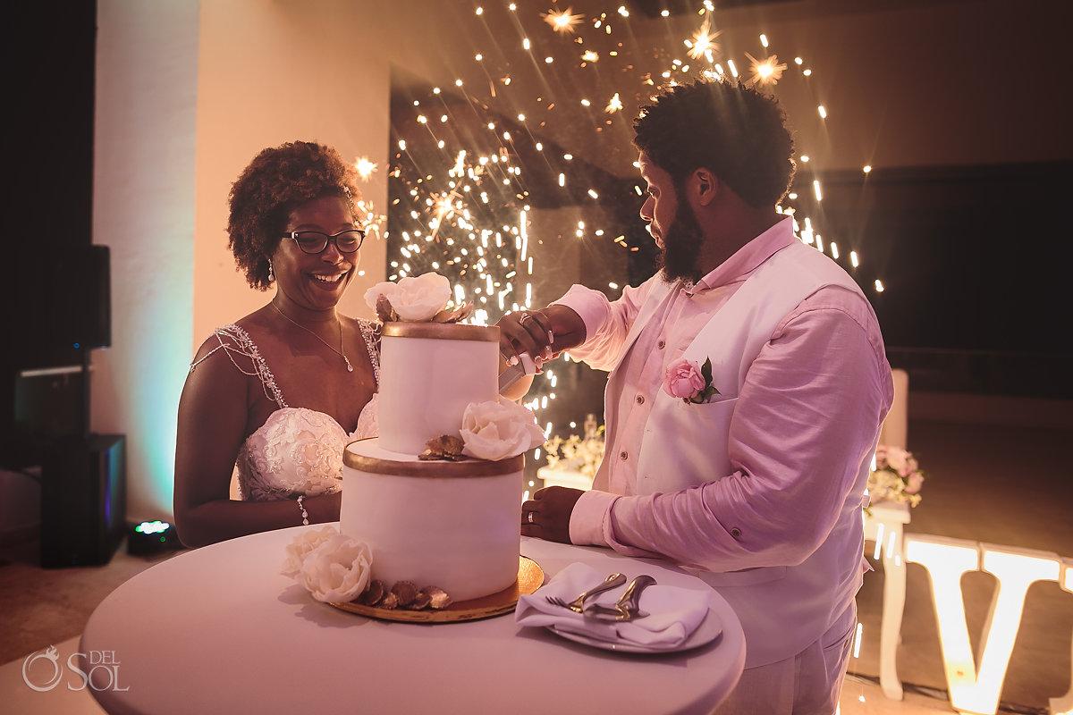 African american couple cutting wedding cake Sky Terrace Hyatt Ziva cancun