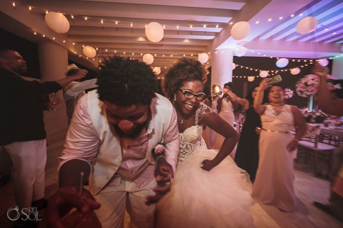 Bride and Groom running through wedding sparklers sky Terrace Hyatt Ziva Cancun