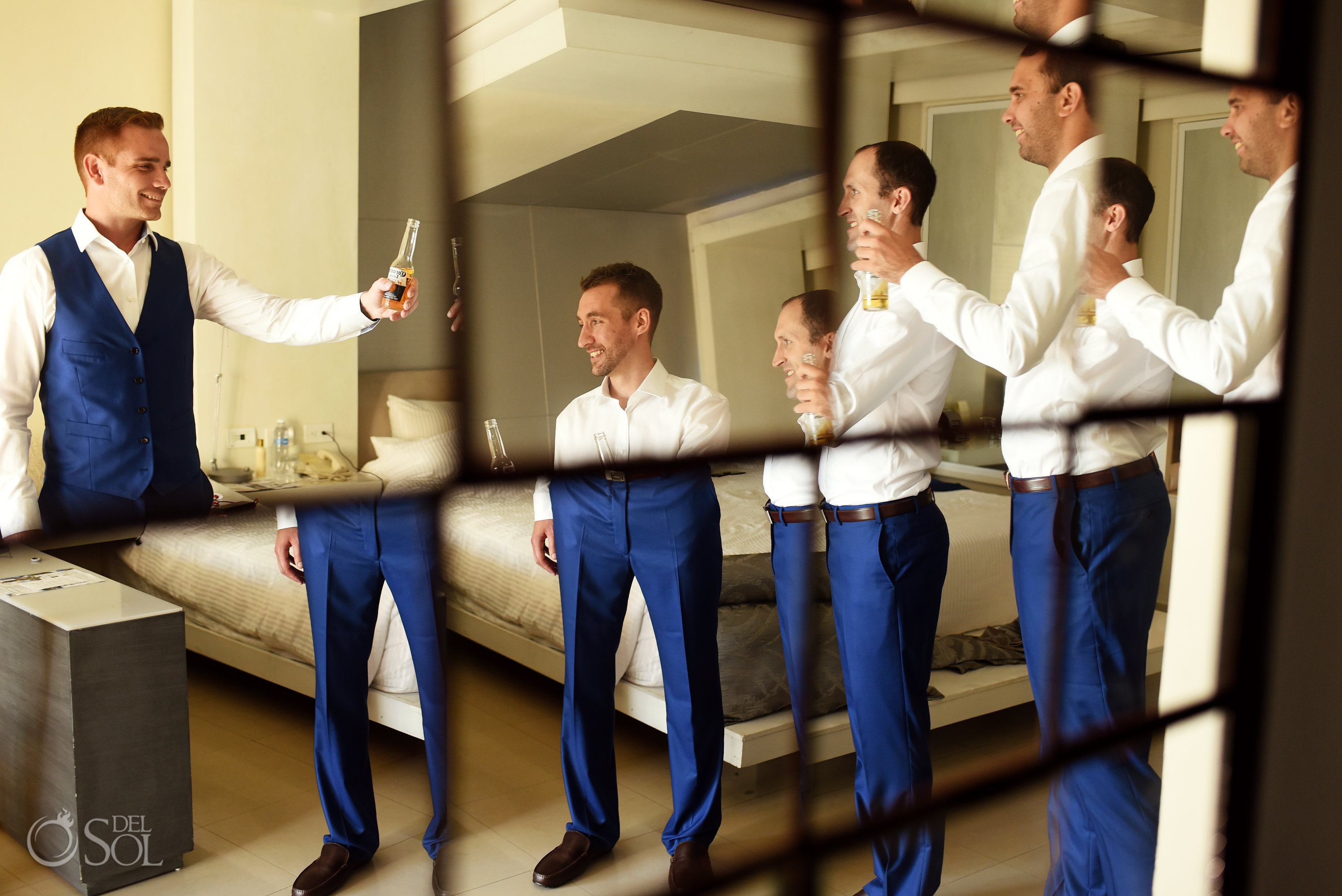 Getting Ready Groom Party Best man Corona Beer Toast Psychedelic Reflection Secrets Silversands Suit Cancun Wedding