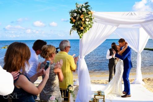 First Kiss newlyweds Beach Front Secrets Silversands Wedding Decoration Ideas family Wedding Cancun