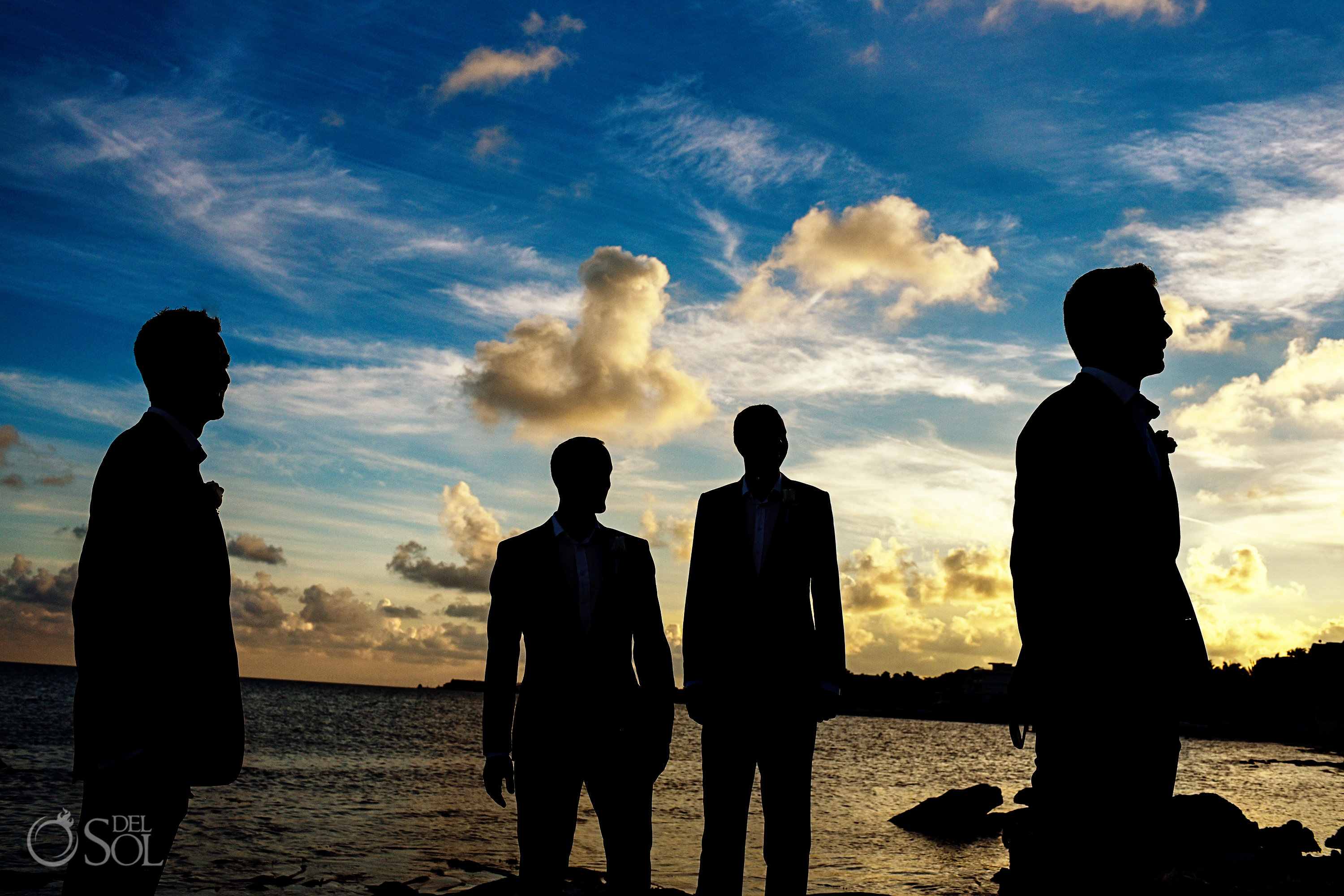 Grooms Party silhouette portrait dramatic sunset sky funny clouds Secrets Silversands Cancun Wedding