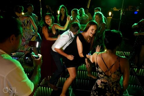 Guest having fun disco floor best dance moment Secrets Silversands Wedding Reception