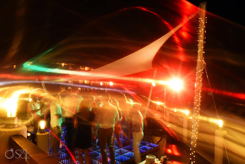 psychedelic lights Guest having fun disco floor best dance moment Secrets Silversands Wedding Reception