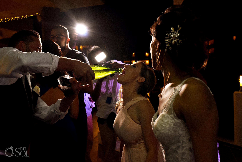 Bridesmaid drinking Champaign best dance moment Secrets Silversands Wedding Reception
