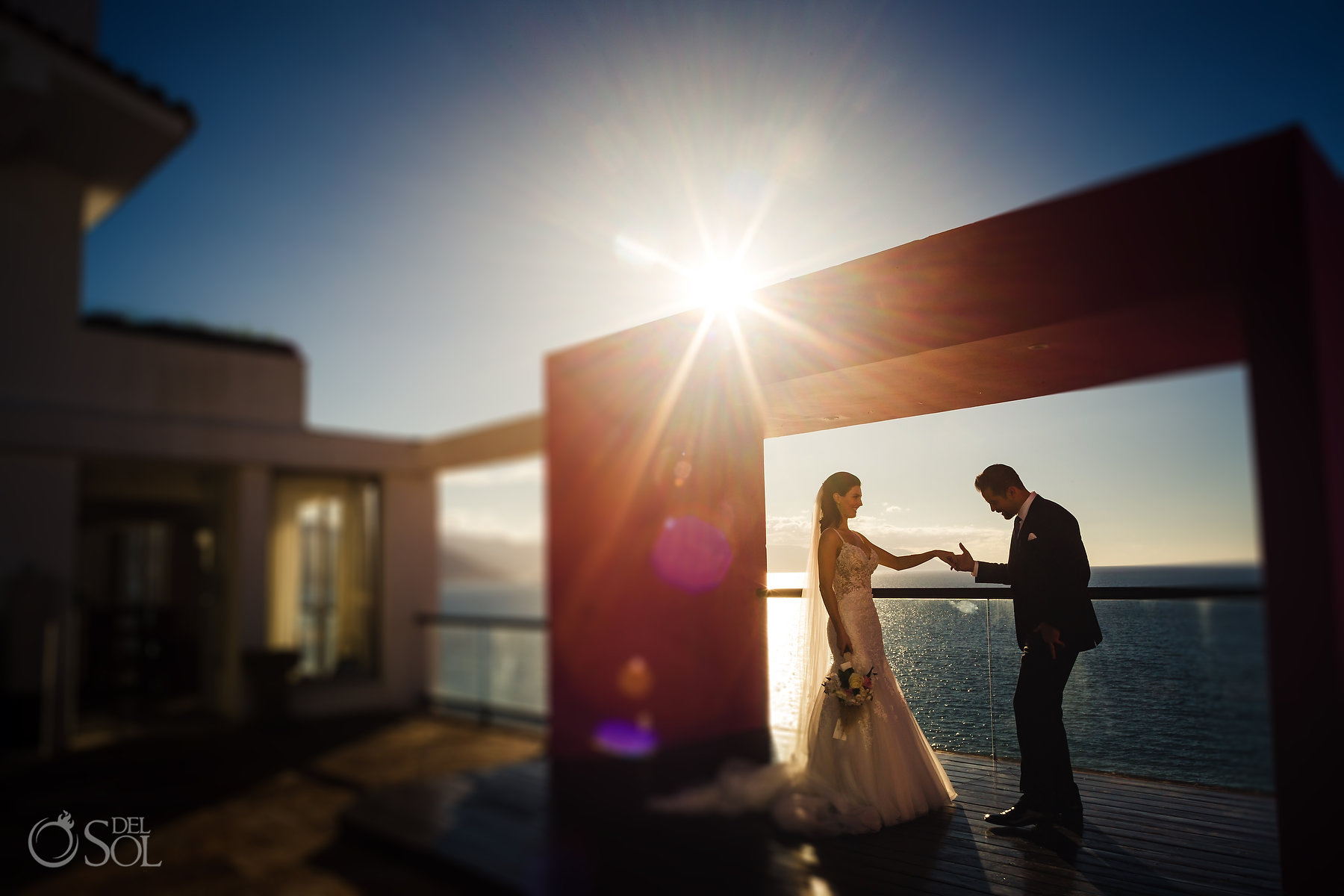 Newlyweds sunset beachfront portraits Hyatt Ziva Puerto Vallarta Wedding