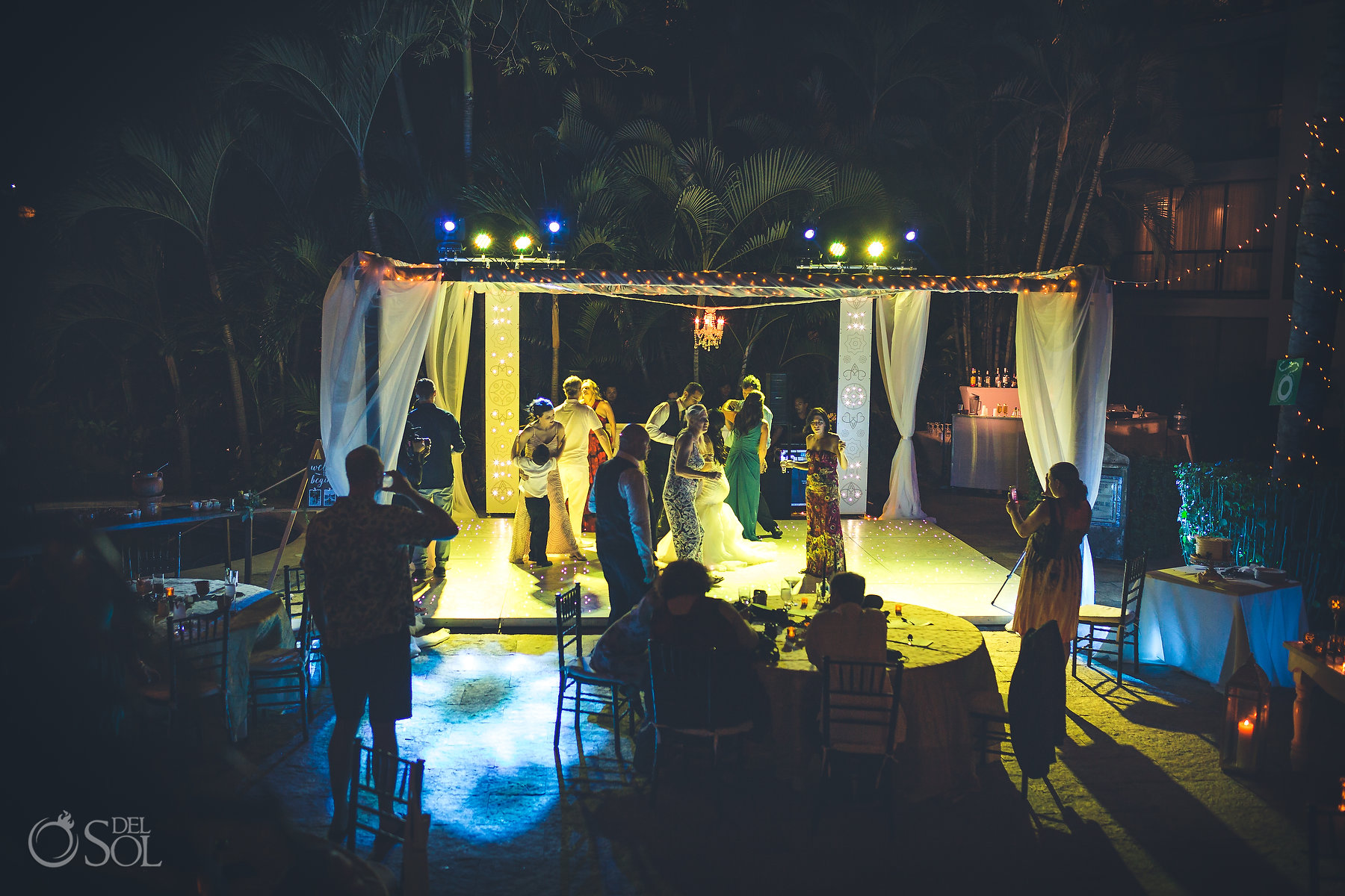 Beachfront wedding reception lights decoration