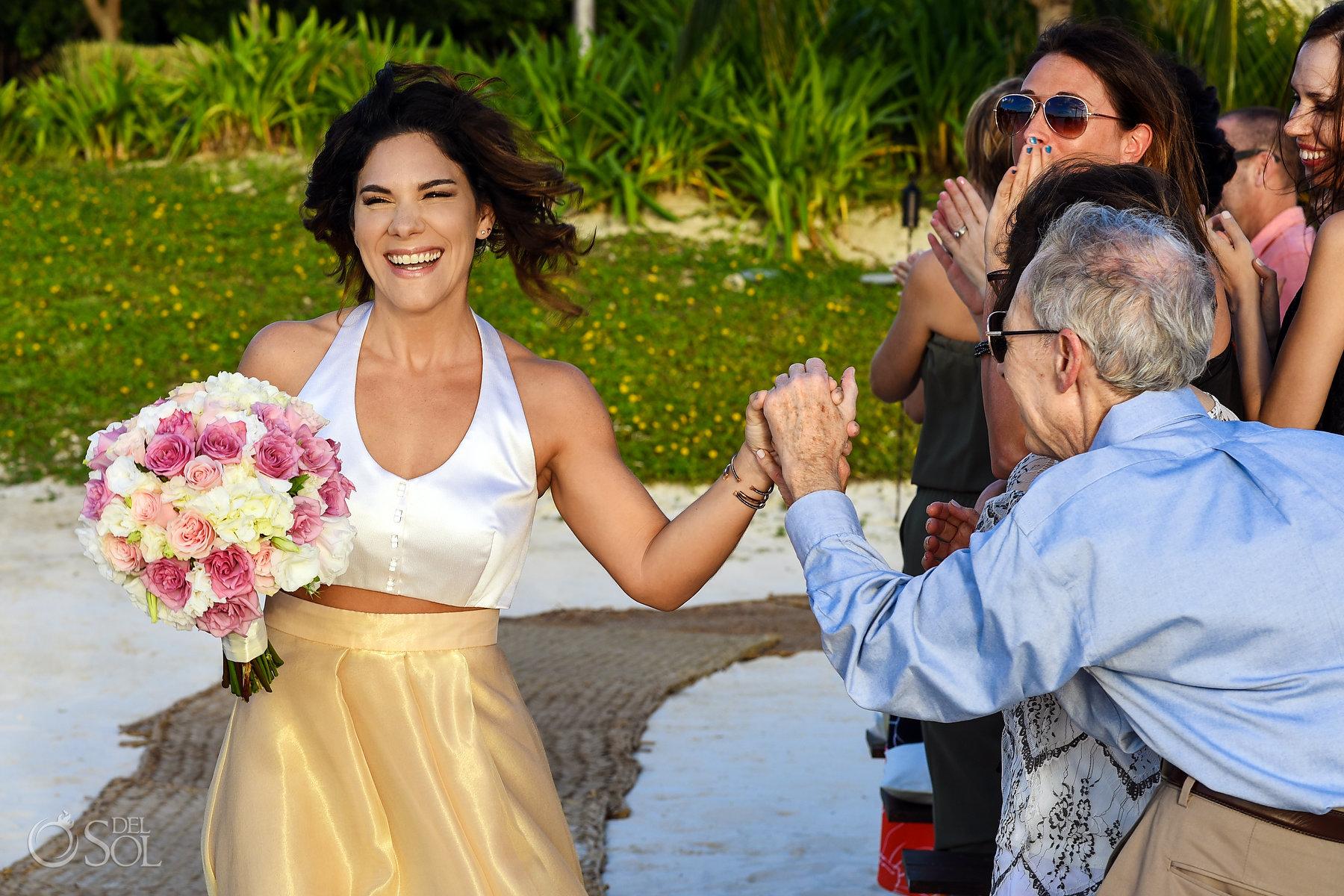 epic bride entrance photography Same Sex Nizuc Wedding