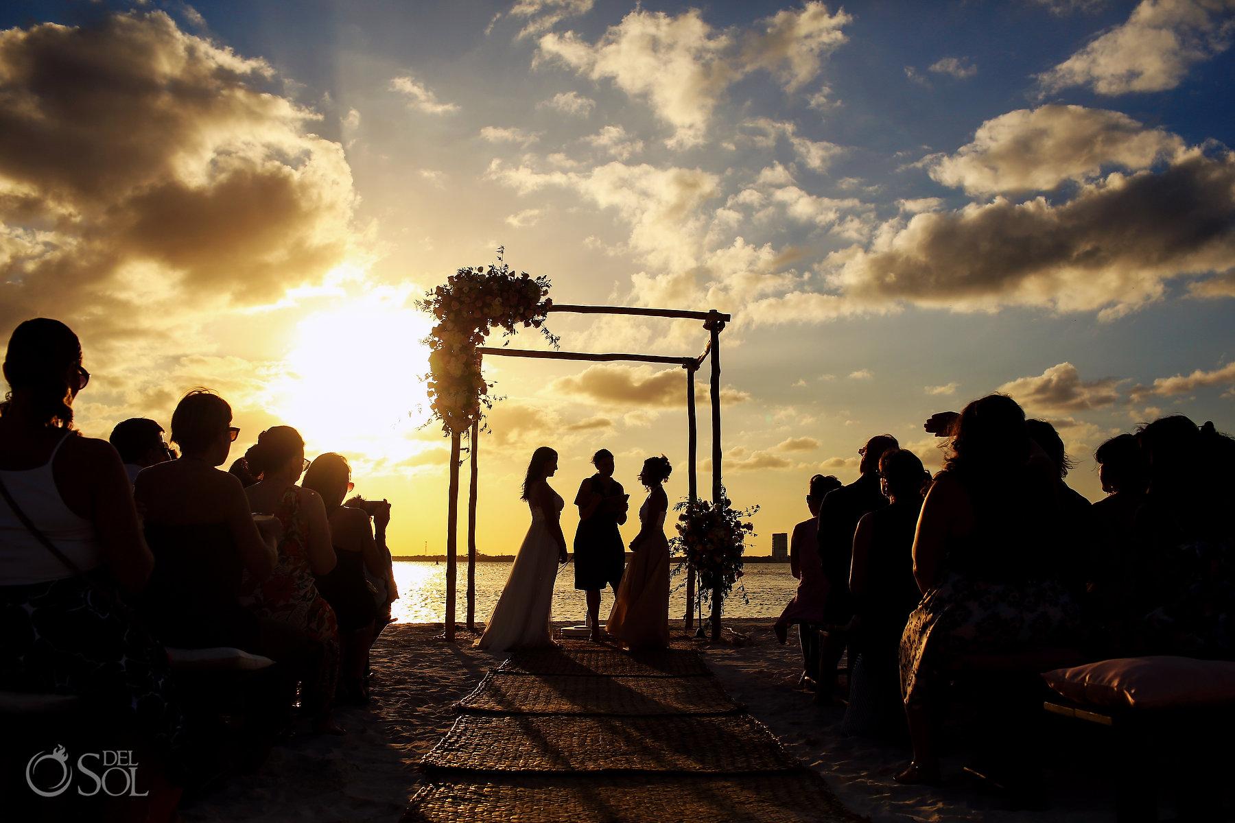 Epic Cancun lakefront ceremony silhouette photography Same Sex Nizuc Wedding