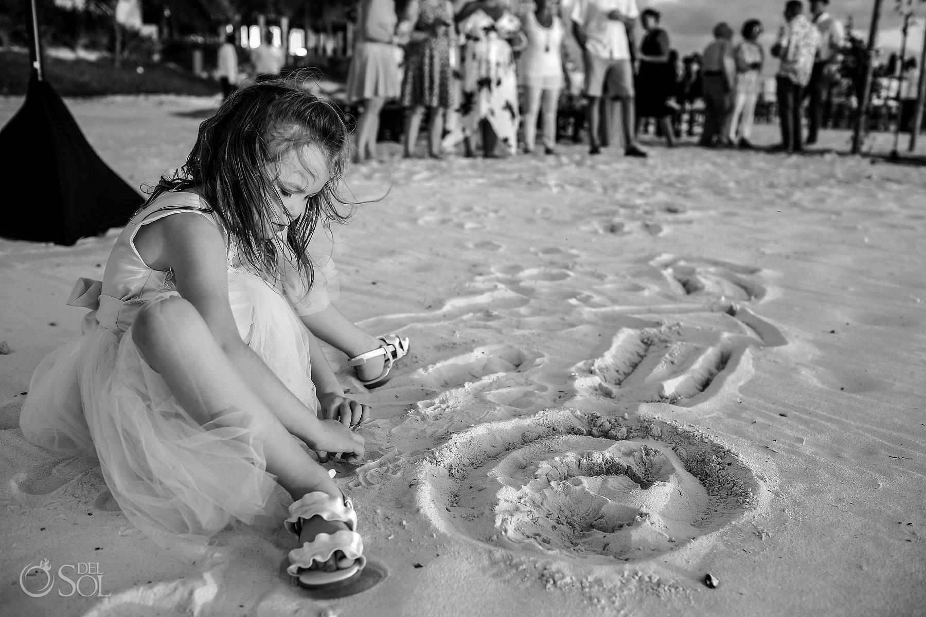 Same Sex Nizuc Wedding Flower girl playing with sand