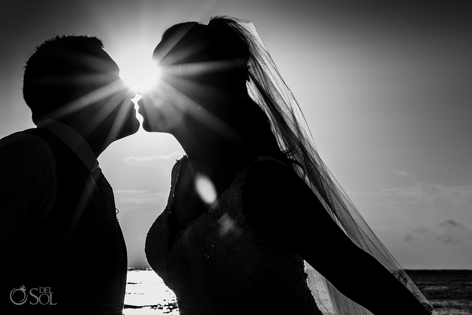 Bride and groom sunrise black and white silhouette portrait