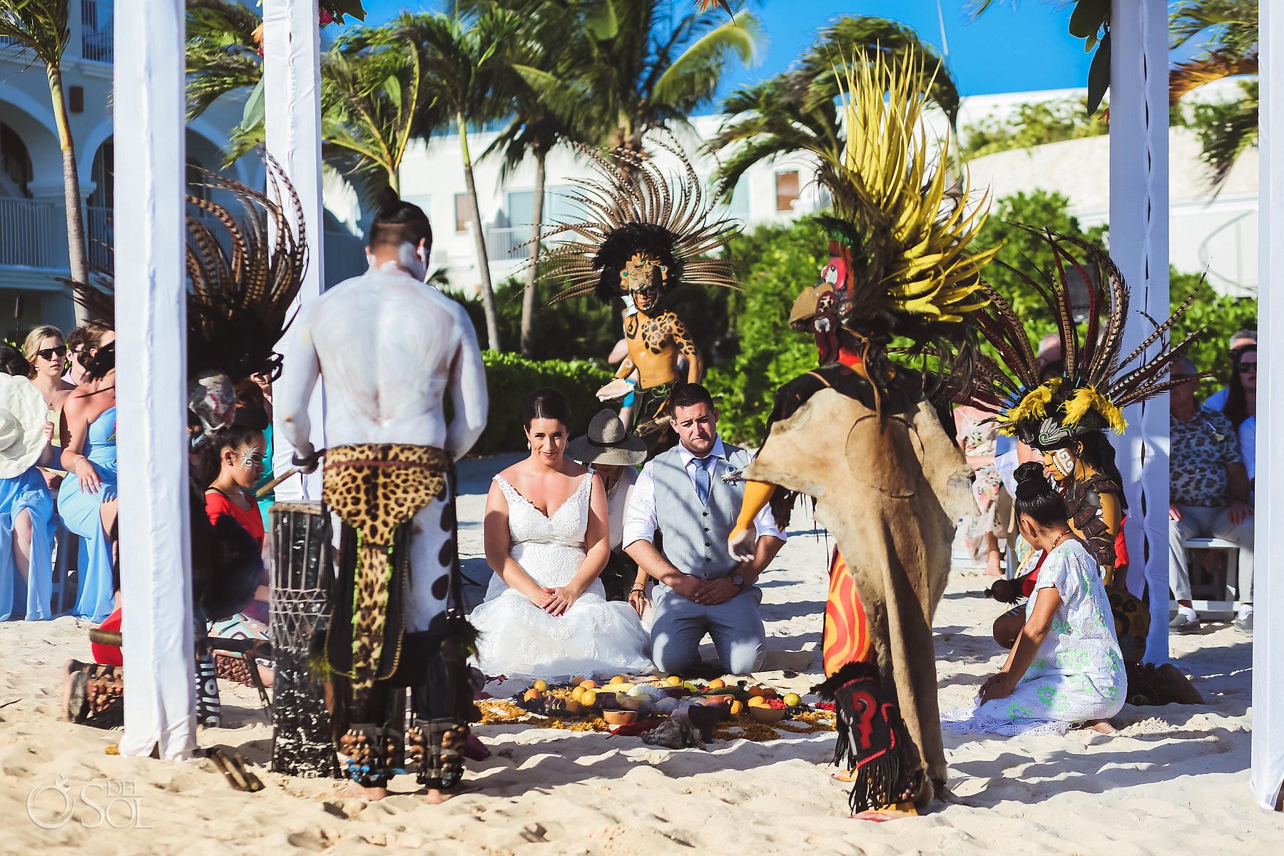 Dreams Tulum Mayan Wedding Bride and Groom sitting in sand