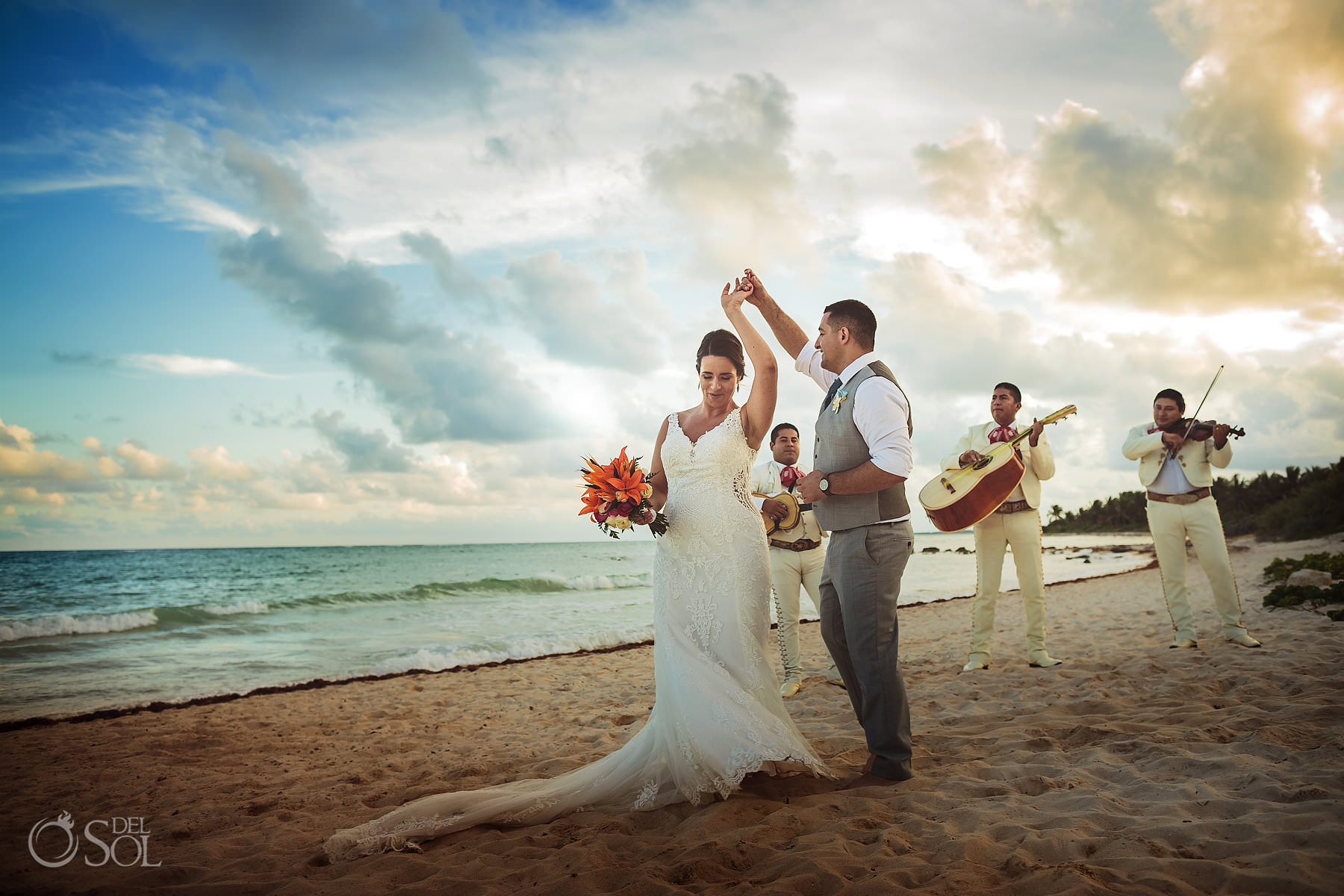Dreams Tulum beach wedding bride groom dancing with Mariachi sunset