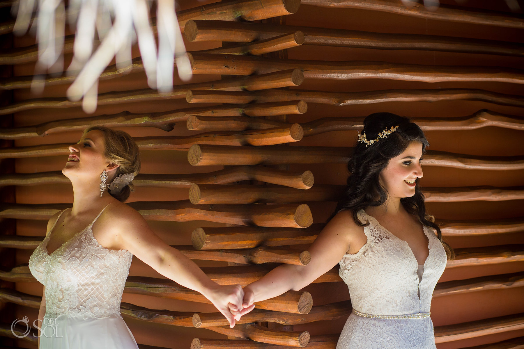 First look holding hands Isla Mujeres lesbian wedding
