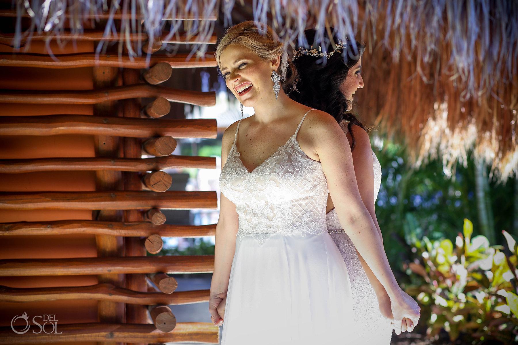 First look back to back hands Isla Mujeres lesbian wedding