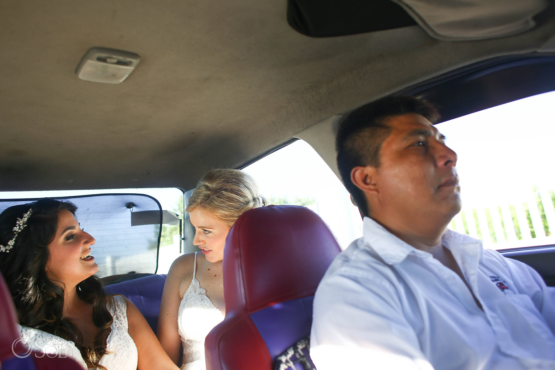 Bride and Bride in a Mexican Taxi Isla Mujeres lesbian wedding