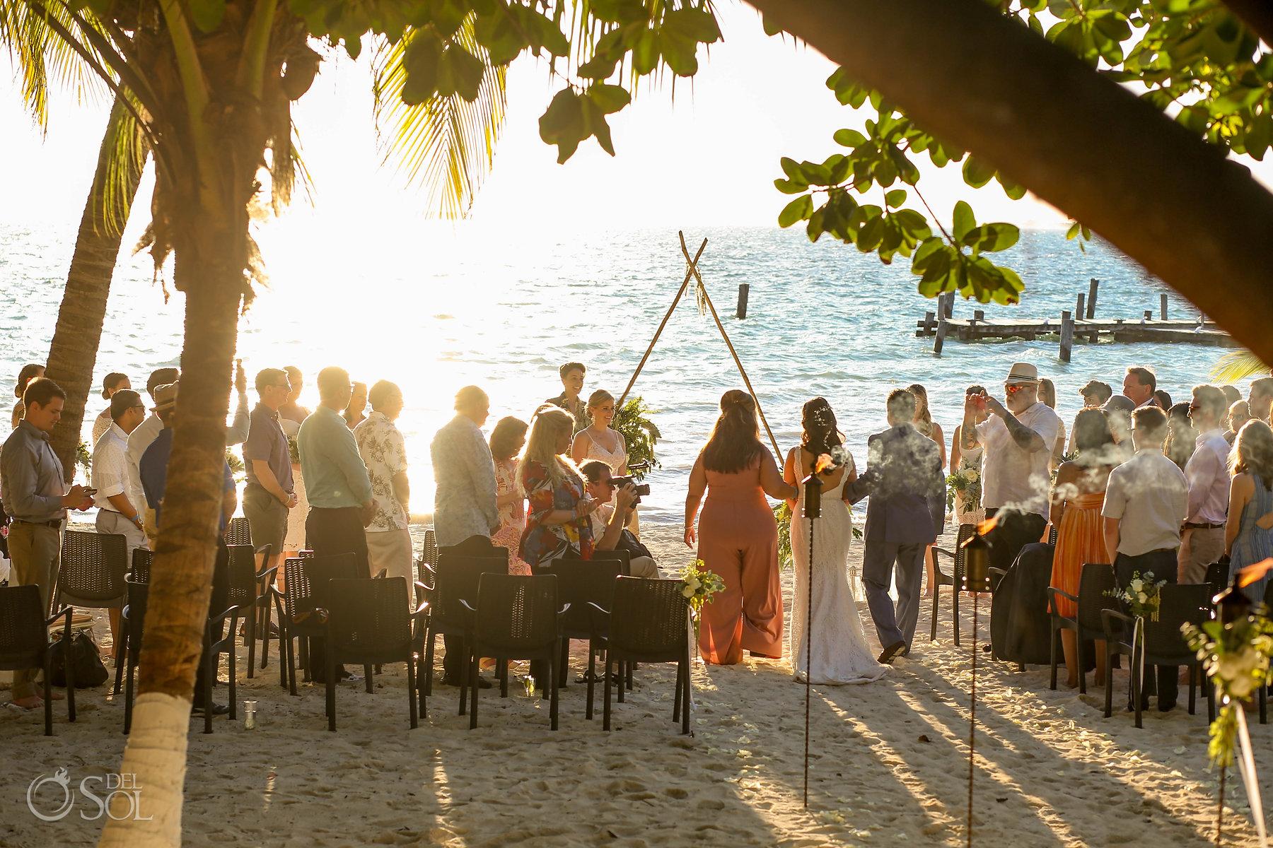 Bride walking to the aisle first look in Isla Mujeres lesbian wedding ceremony Zama Beach