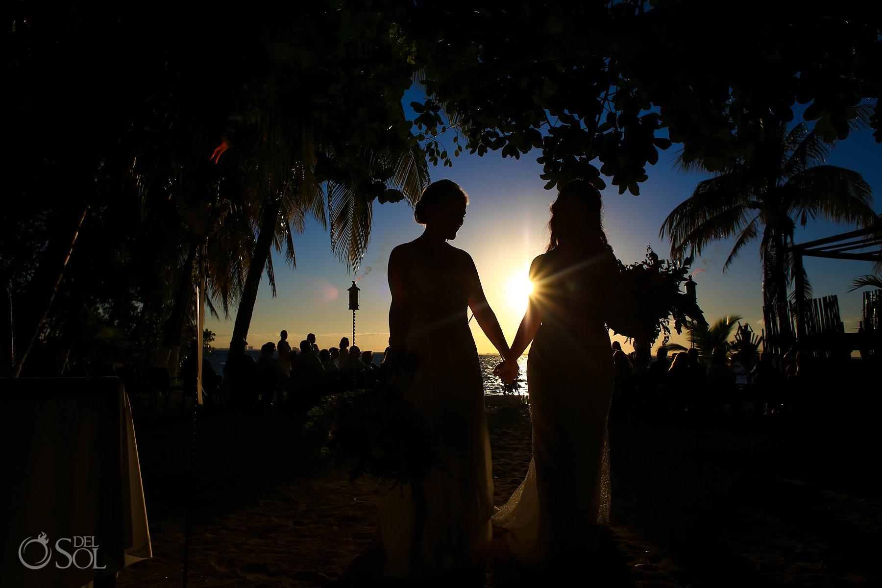 Just marriedbride and bride silhouette sunset Isla Mujeres lesbian wedding ceremony Zama Beach