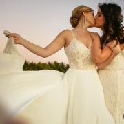 Homosexual Brides Kissing at Isla Mujeres lesbian wedding Zama Beach