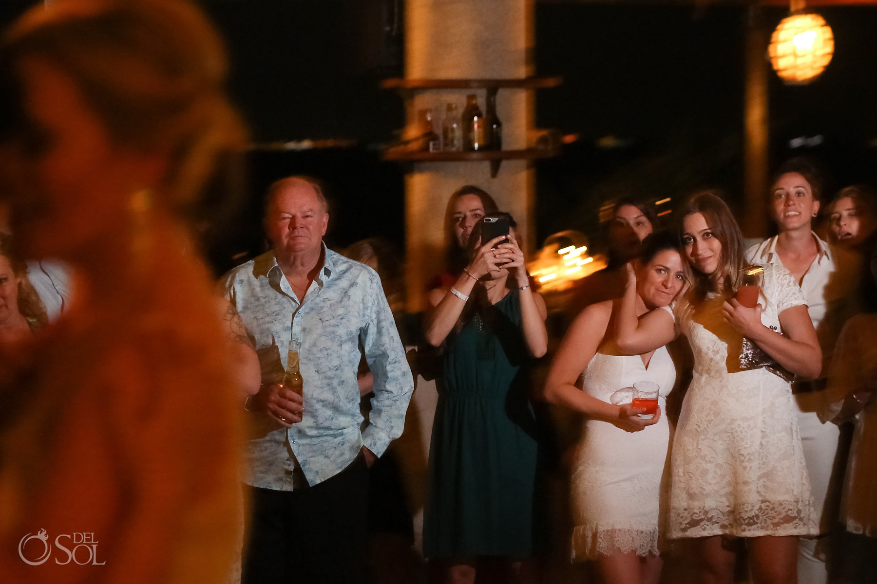 Wedding party loving homosexual brides first dance in Isla Mujeres lesbian wedding reception Zama Beach