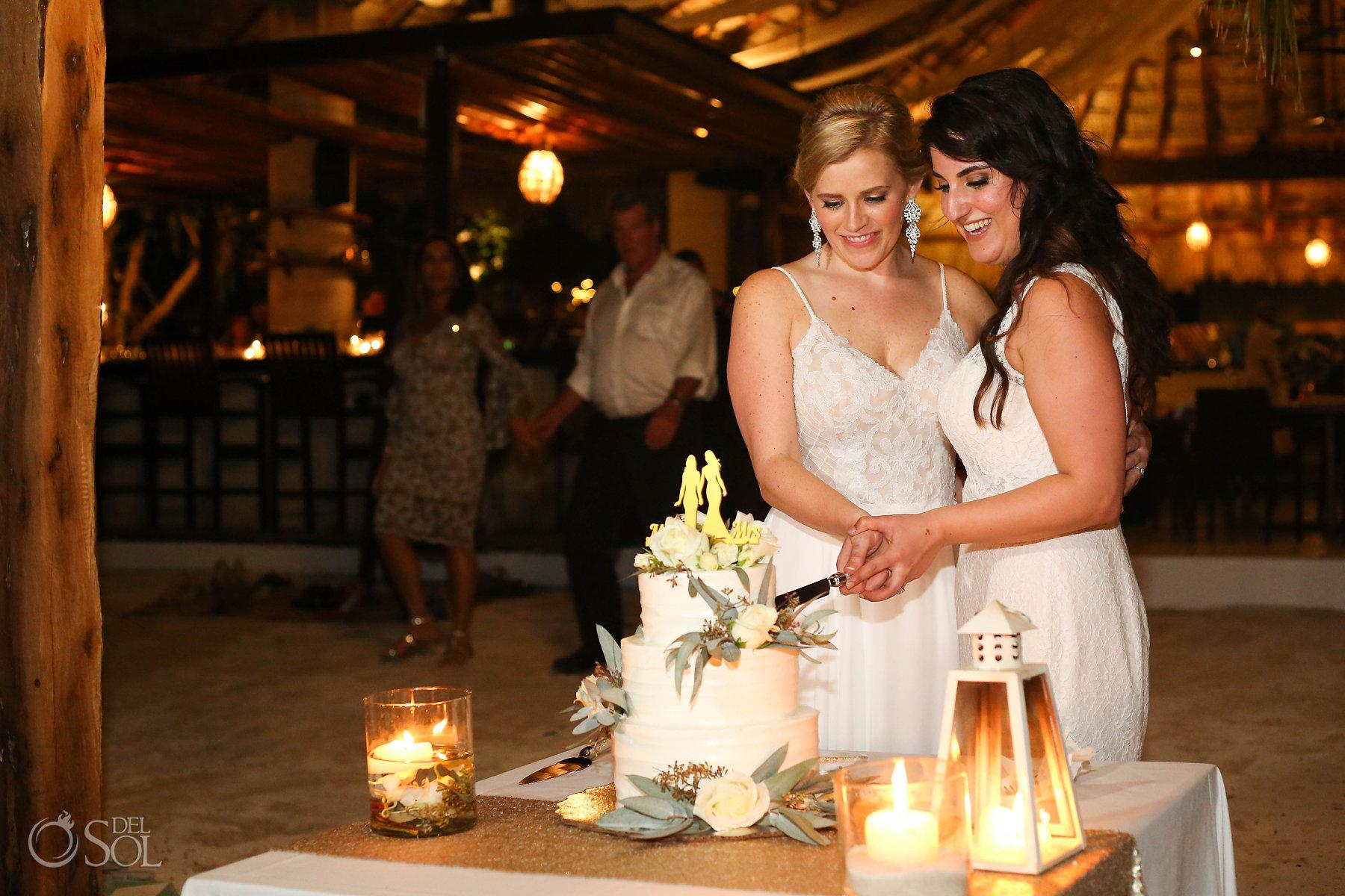 queer lesbian lgbt Brides cutting cake