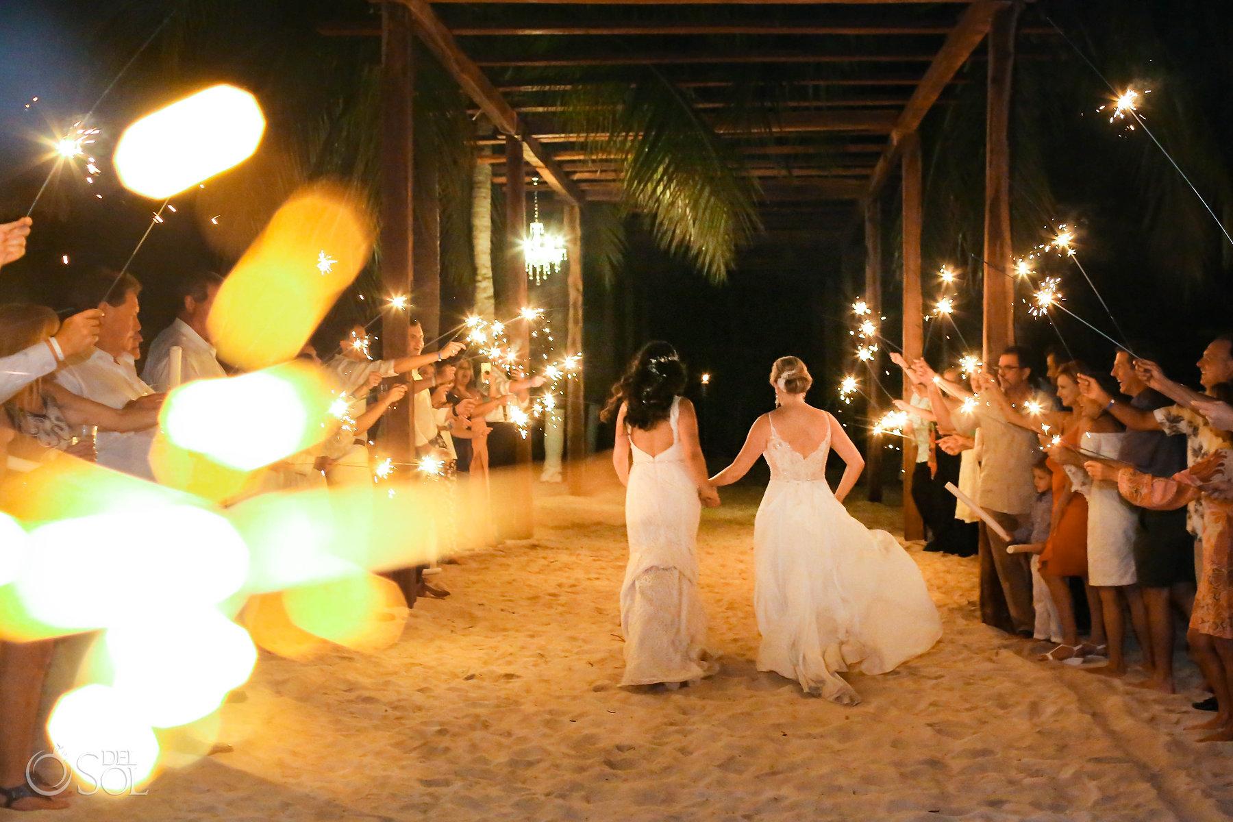 LGBT Wedding Sparklers lesbian brides running at Isla Mujeres reception Zama Beach
