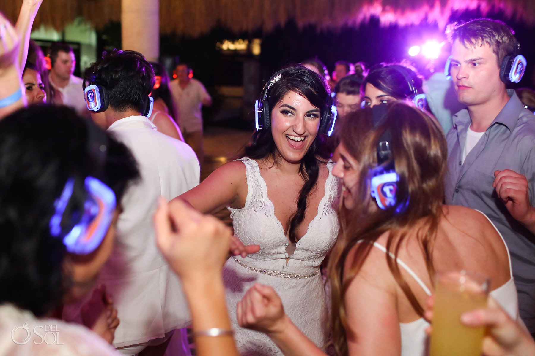 Lesbian Bride dancing at queer silent disco wedding reception