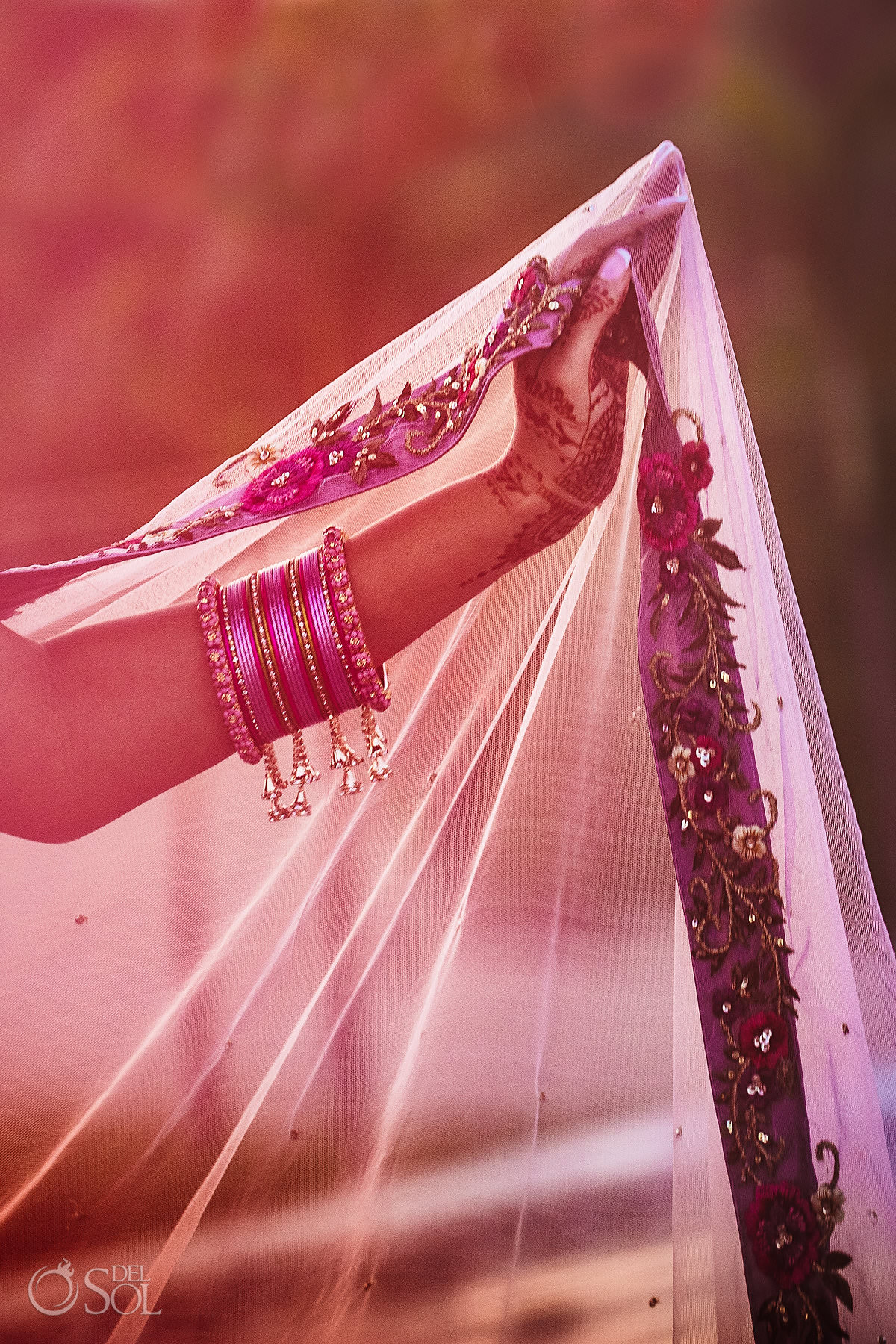 Indian destination wedding portrait hand mehndi detail pink bracelets veil