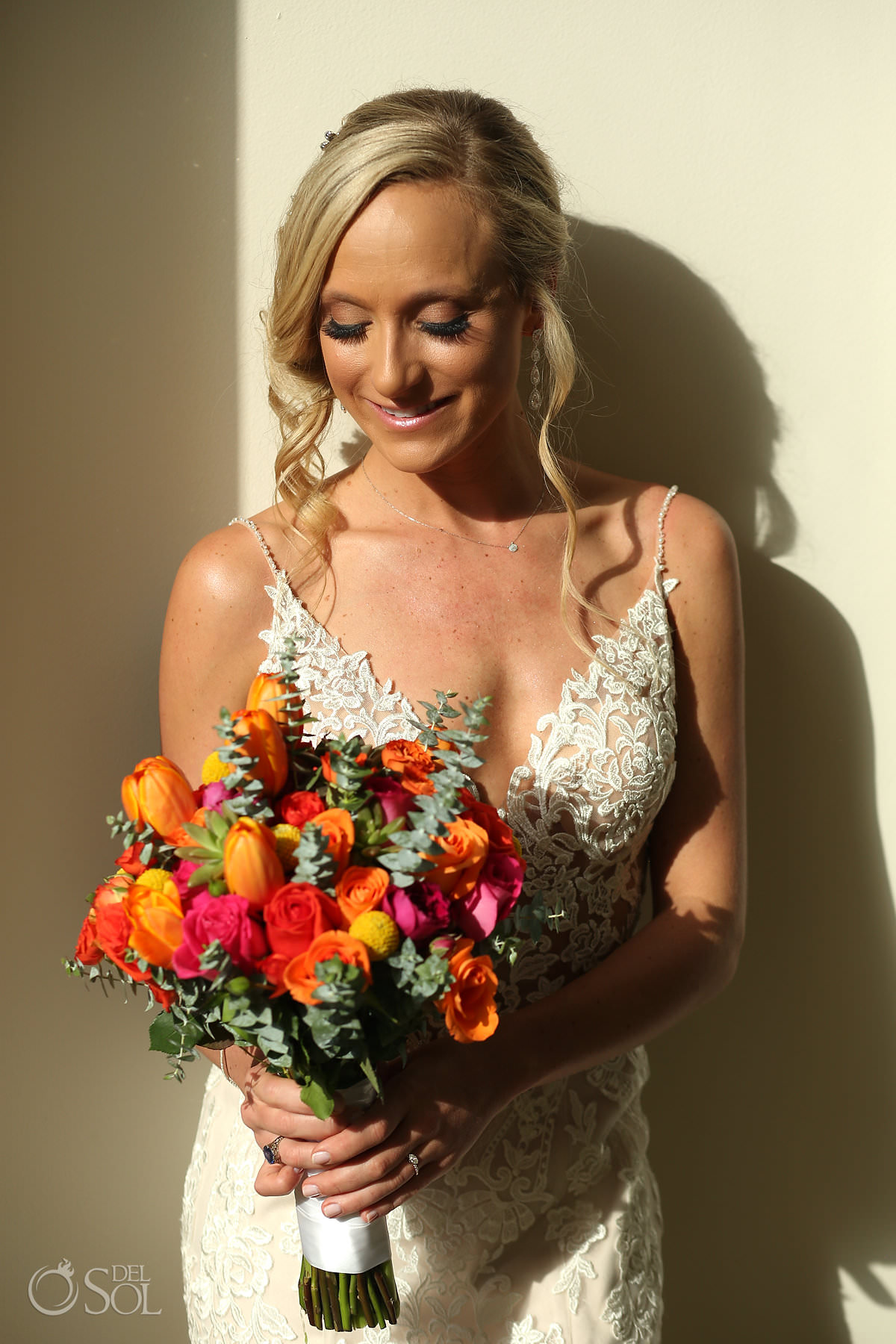 Bride with flower bouquet Andaz Mayakoba Wedding
