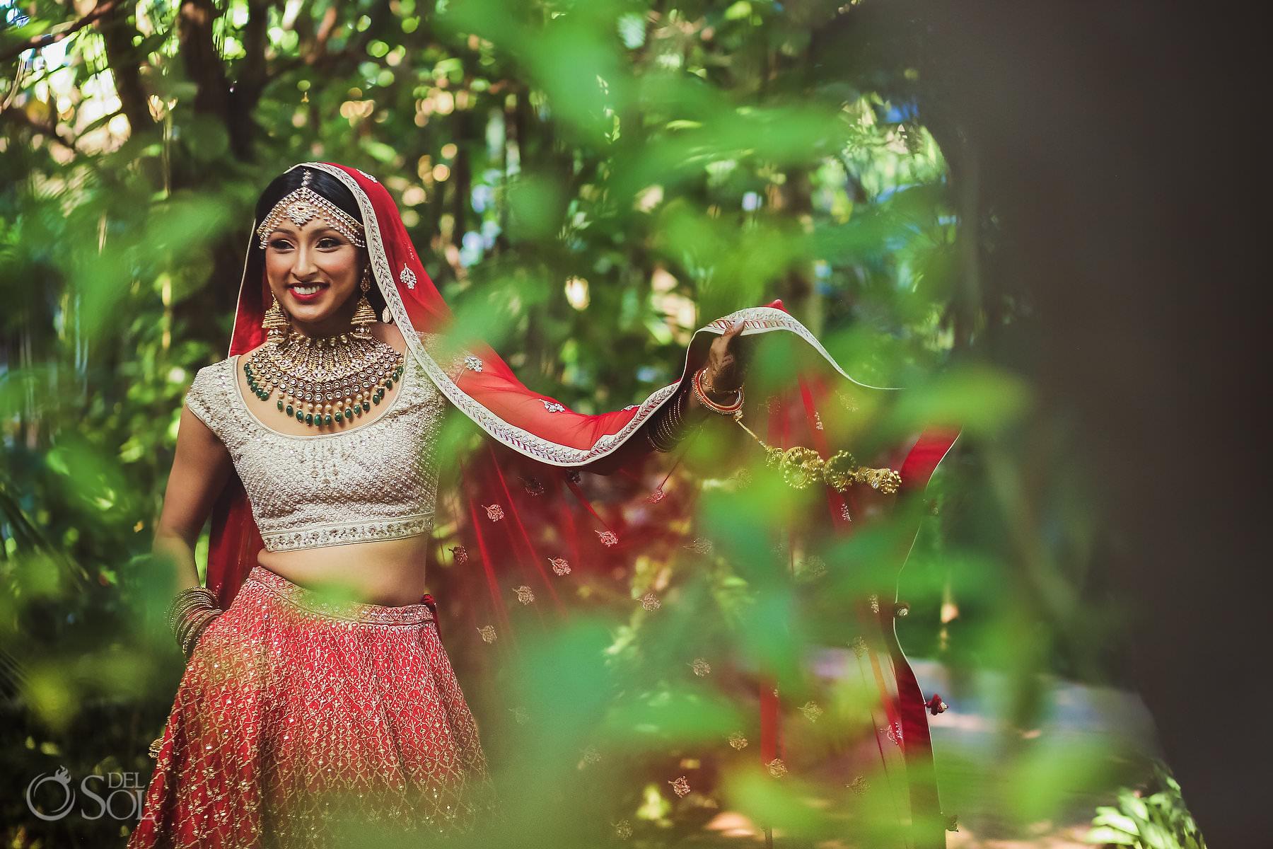 Indian bride wearing red lehenga Dreams Tulum Hin-Jew Wedding Riviera Maya Mexico