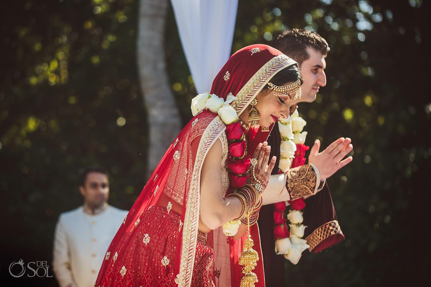 Prayer to Ganesha Couple bow wearing Floral Garlands Hindu wedding ceremony Mexico Dreams Tulum Riviera Maya