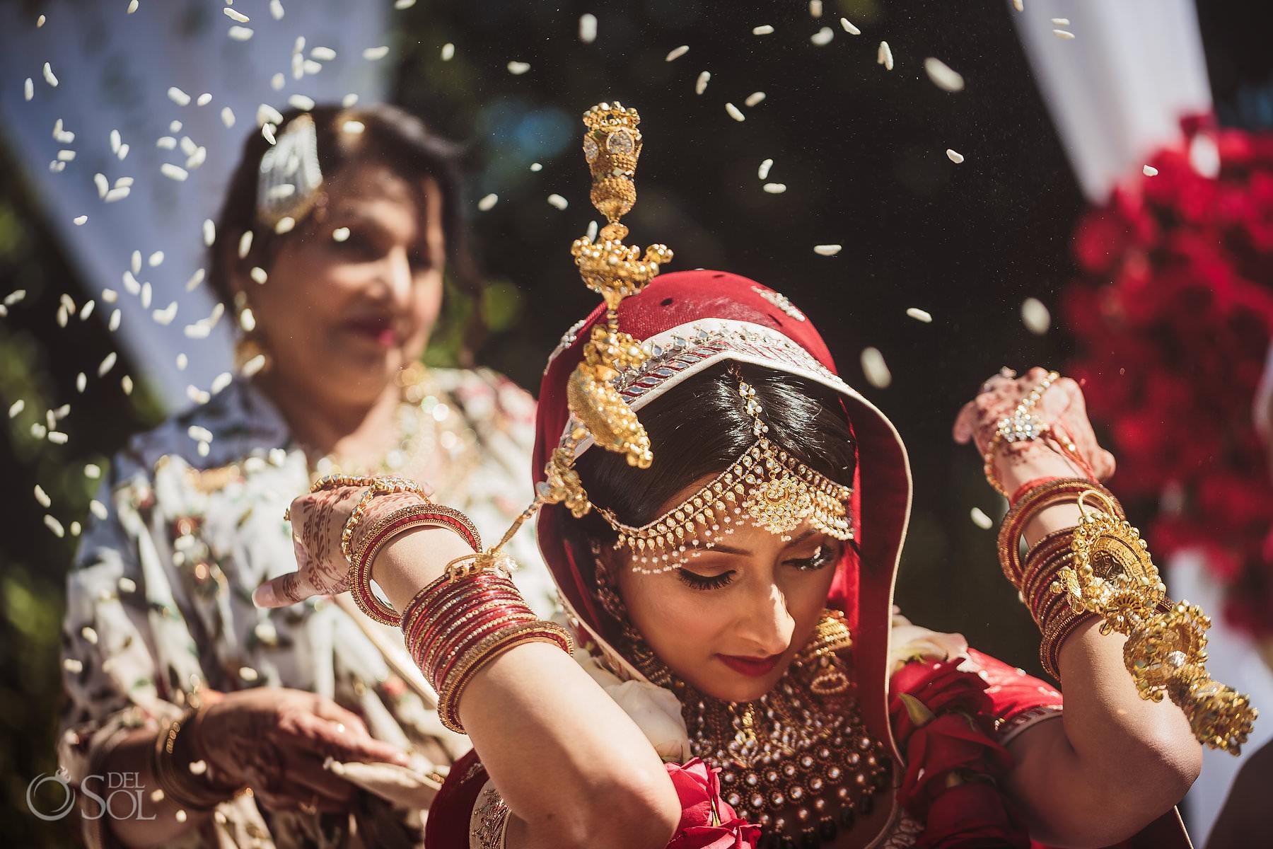 Vidaai Indian bride throwing rice over her head Dreams Tulum Hindu Wedding tradition Riviera Maya Mexico