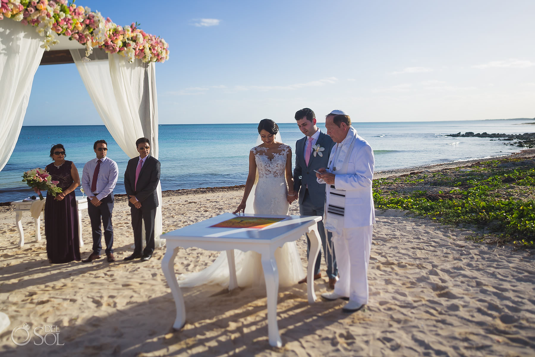 Dreams Tulum Jewish Wedding signing the ketubah