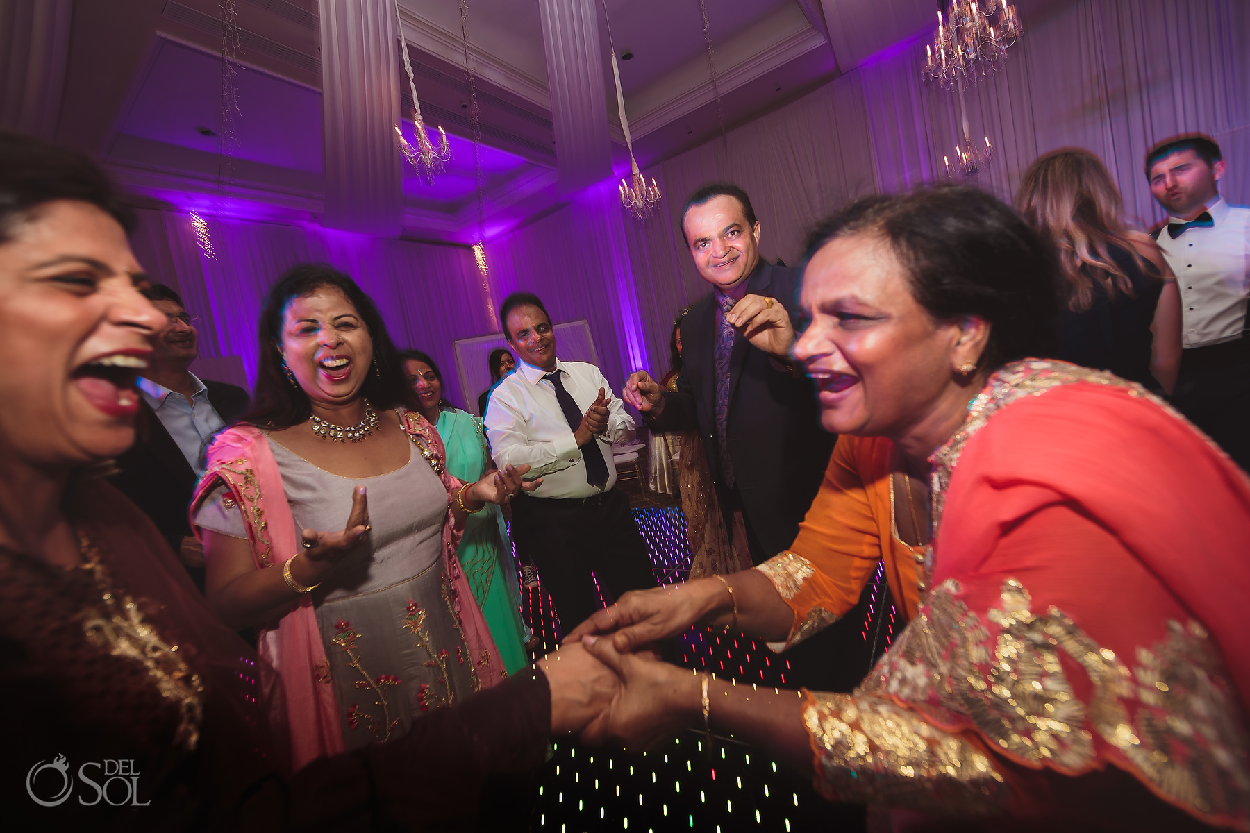 Indian family dancing at Dreams Tulum Jewish Wedding Reception
