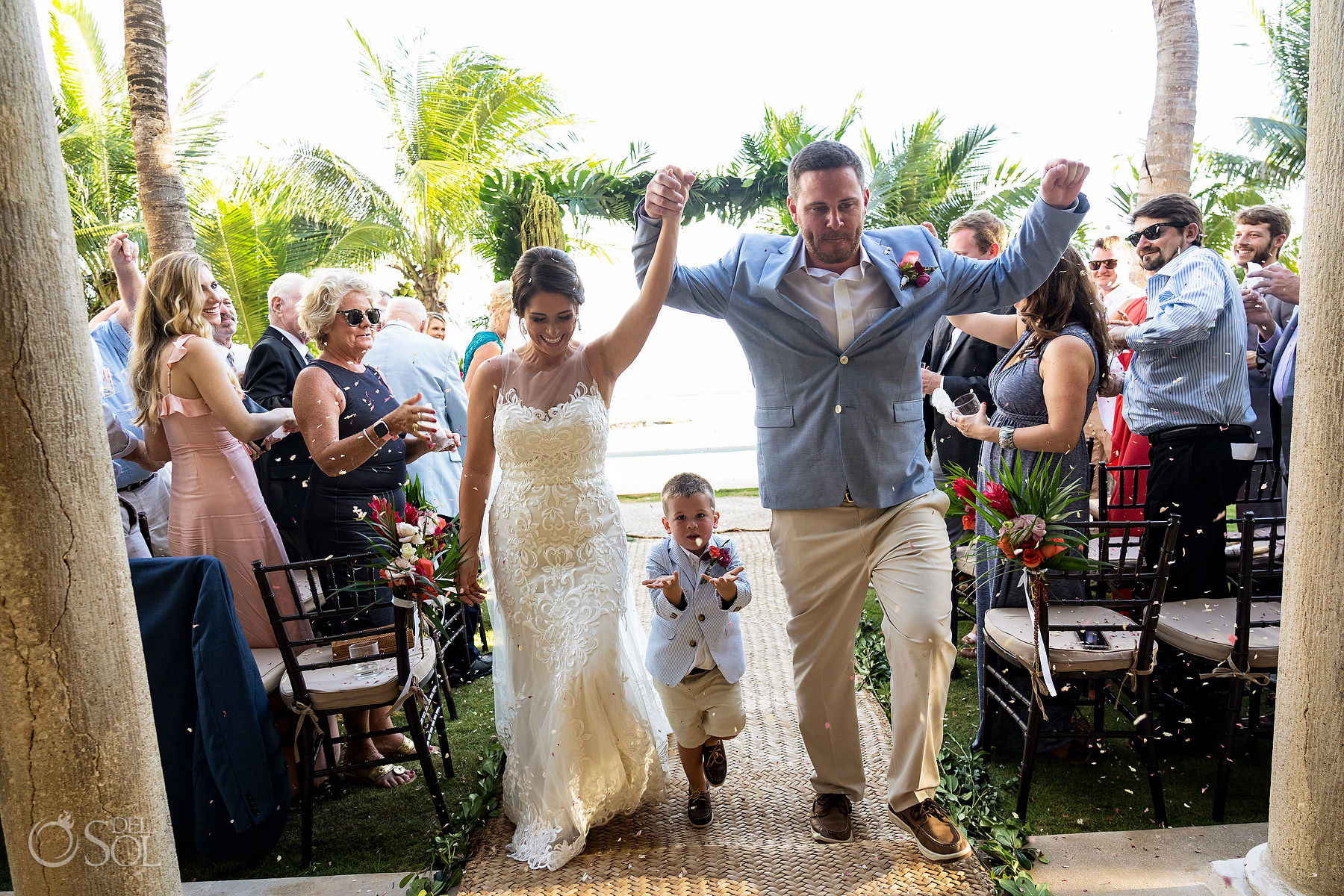 Just married walking out the Ceremony with son playing popurri riviera maya villa wedding
