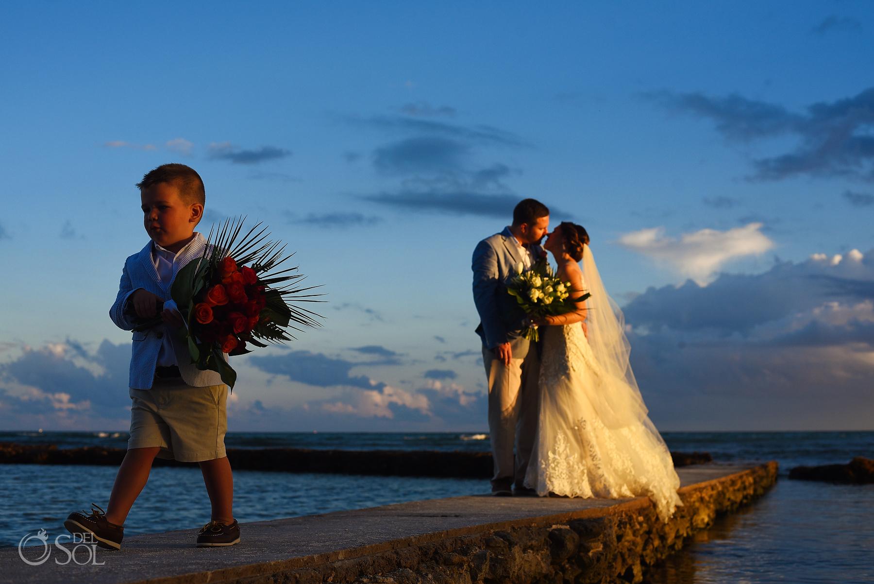 Puerto Aventuras kid with bouquet golden hour just married riviera maya villa wedding